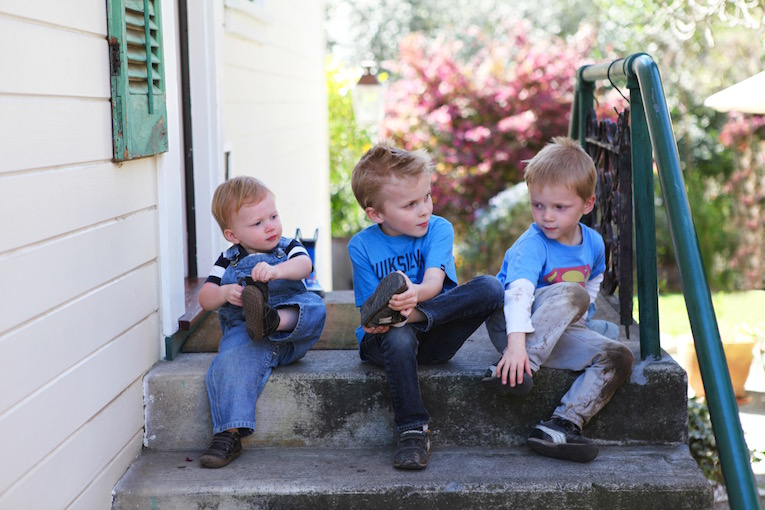 My three sons, taking their shoes off before heading inside our home.