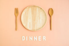 top-view-wooden-cutlery-dinner-word-dish-fork-spoon-wording-light-orange-background-80461900.jpg