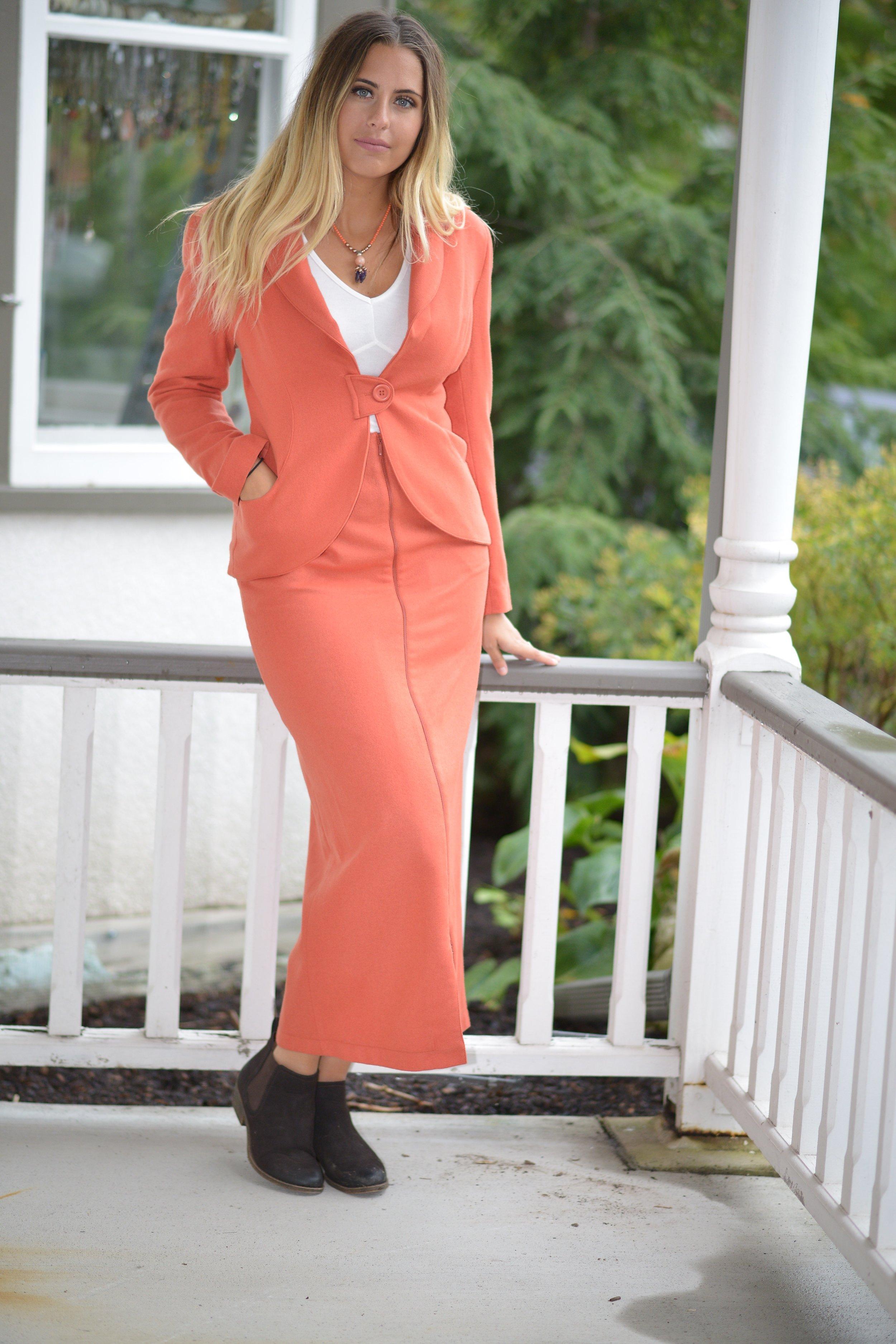 Button tab jacket and zipper skirt
