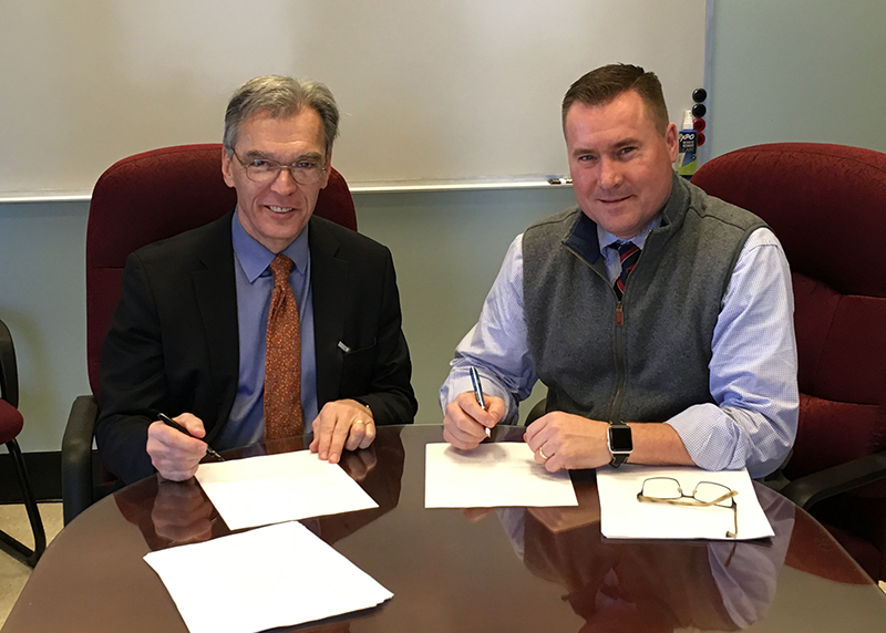 Bostonian Society President Executive Director Brian W J   LeMay at the lease signing with Gregory Rooney, Commissioner   of the City of Boston Property Management Department.