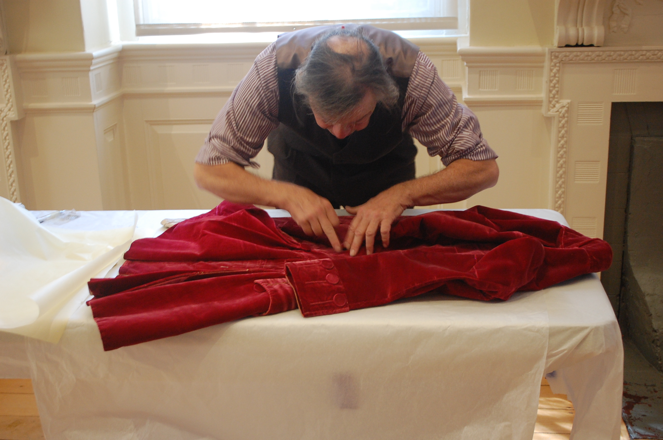 He began by thoroughly examining the coat.