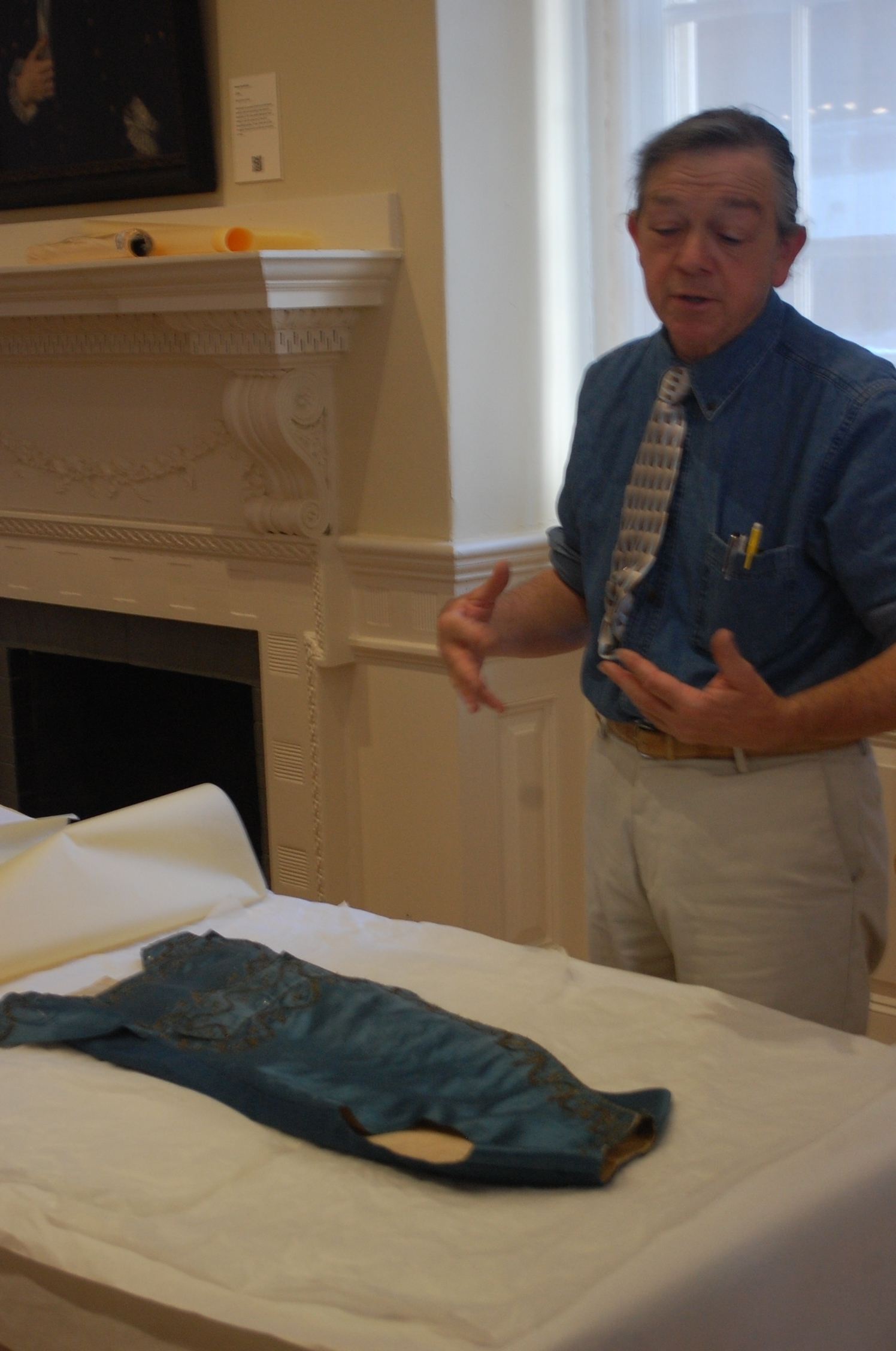 Throughout the process, Henry answered questions from visitors and staff about the garments and how they were originally made, as well as questions about what his process would be when he constructs the reproductions.
