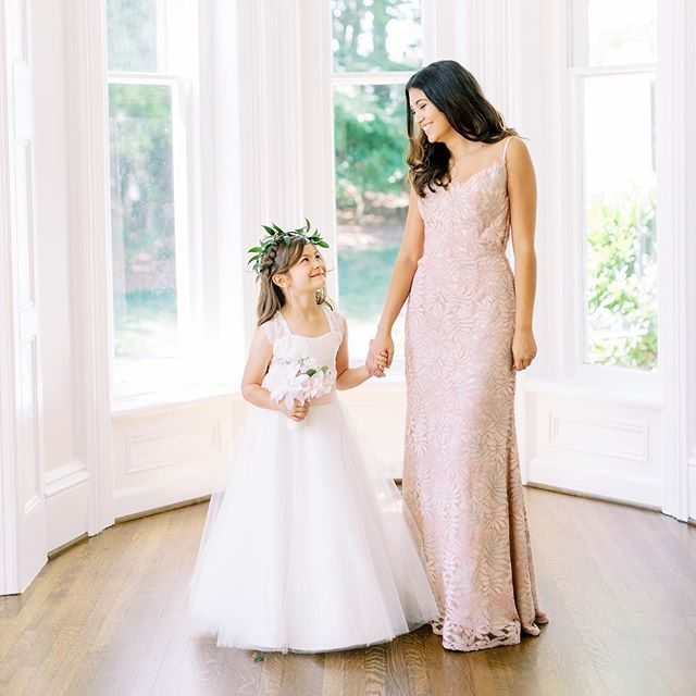 How adorable is this picture from our styled shoot with @mcalisterleftwich and @megantravisphotography, I mean we are in love! The bridesmaids dress is by @watters and this custom flower girl dress is by one of our exclusive in house dress designers! We love the ivory and blush colors together, tell us what your wedding colors are below 👇🏼