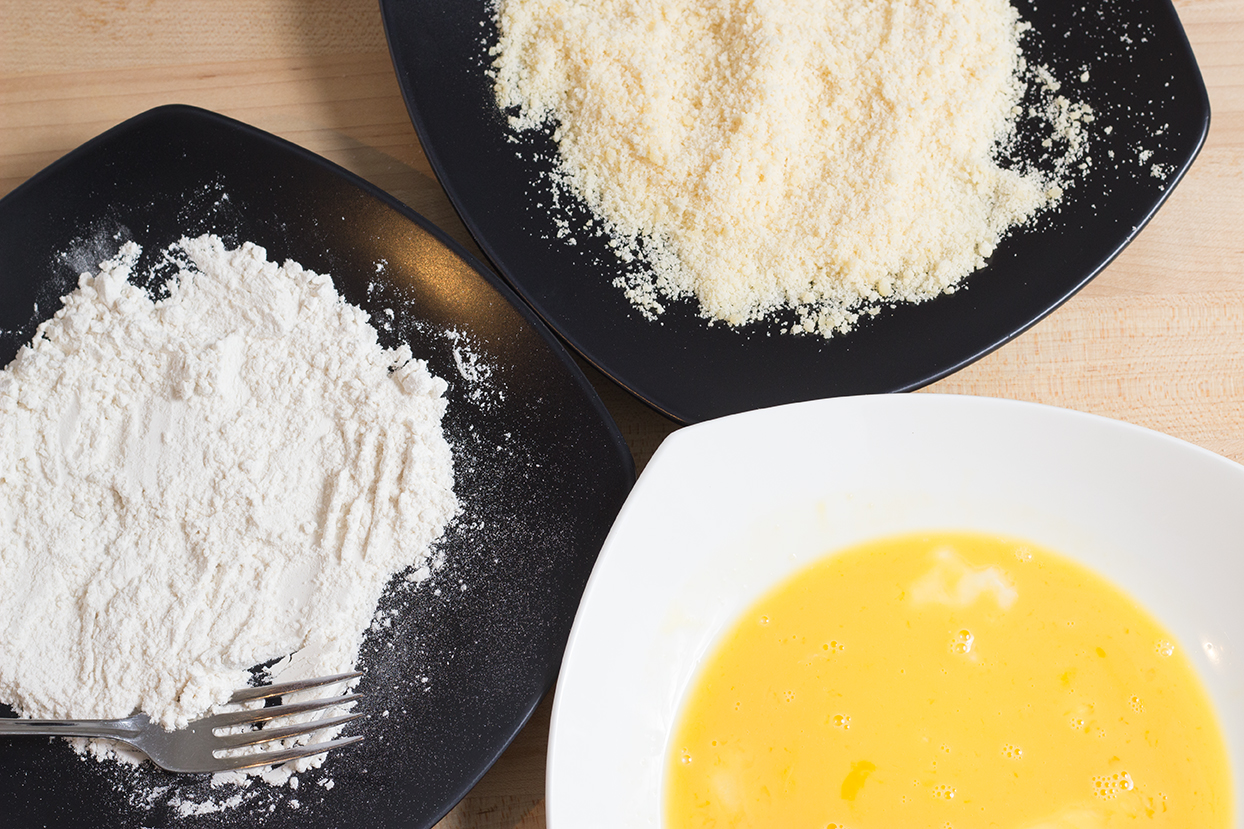 These are your breading dishes: flour, washed egg and parmesan.