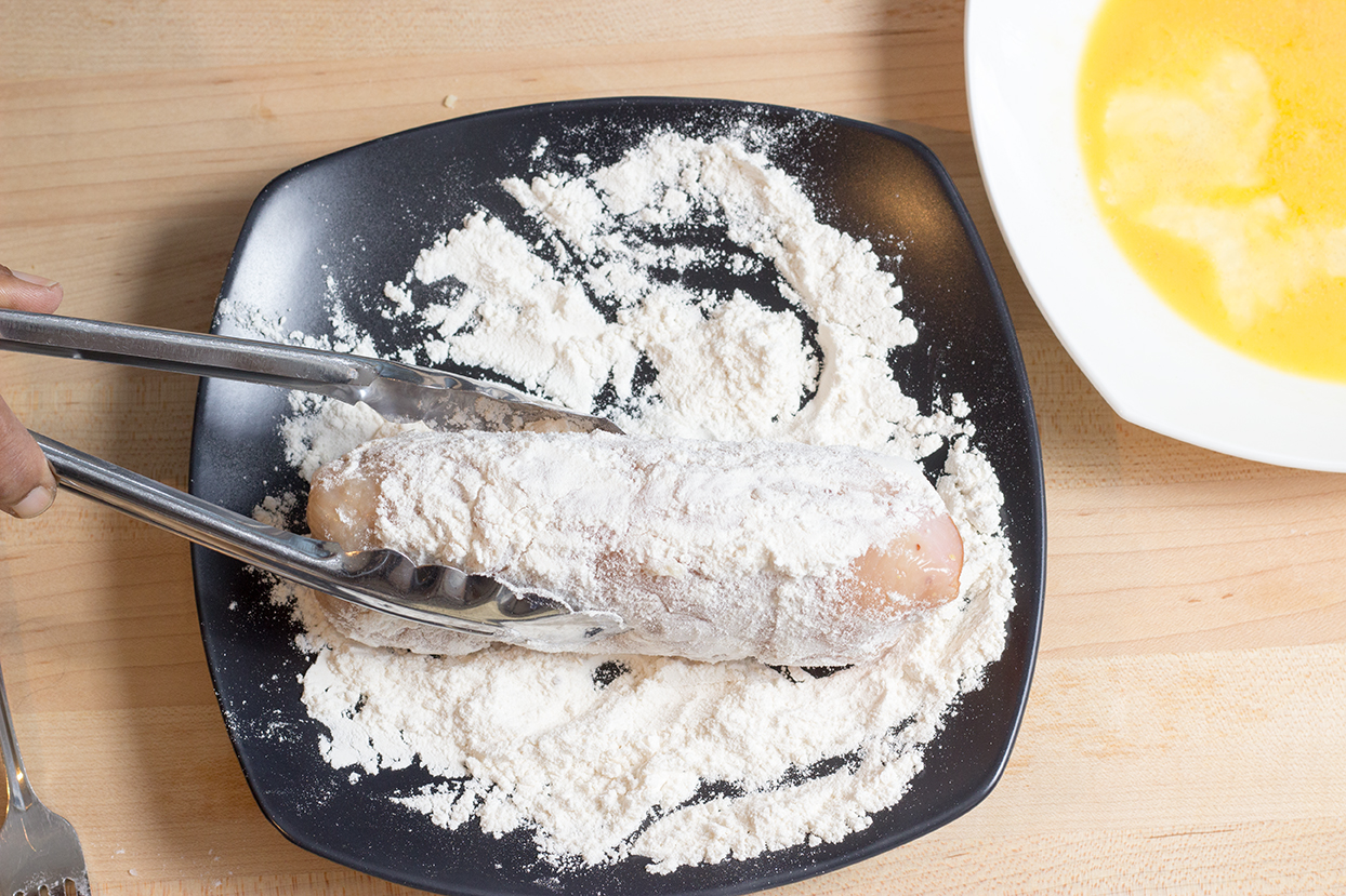 Roll the stuffed breast in the flour.  Shake off excess flour.