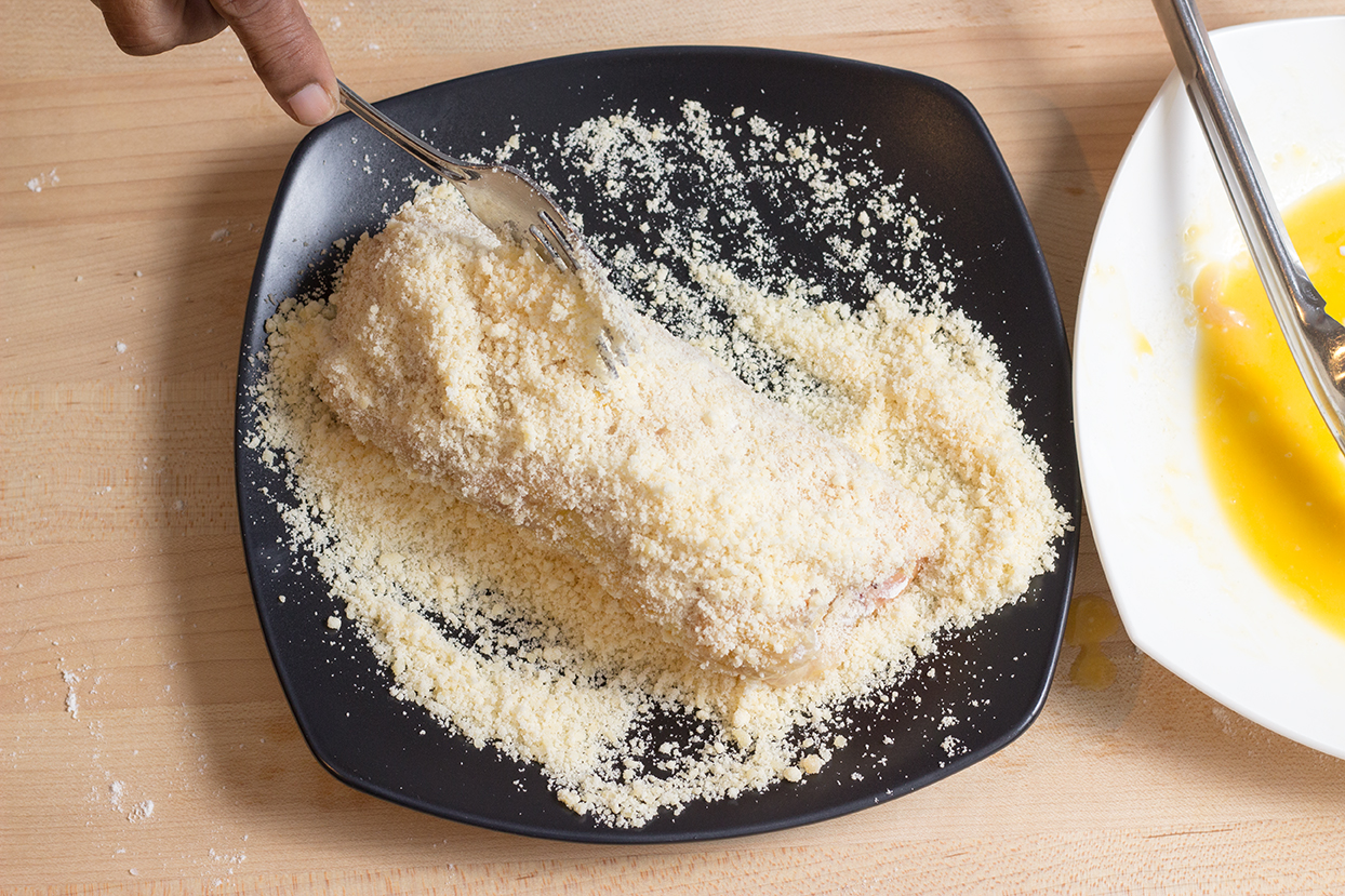 Finally roll the breast in the parmesan.