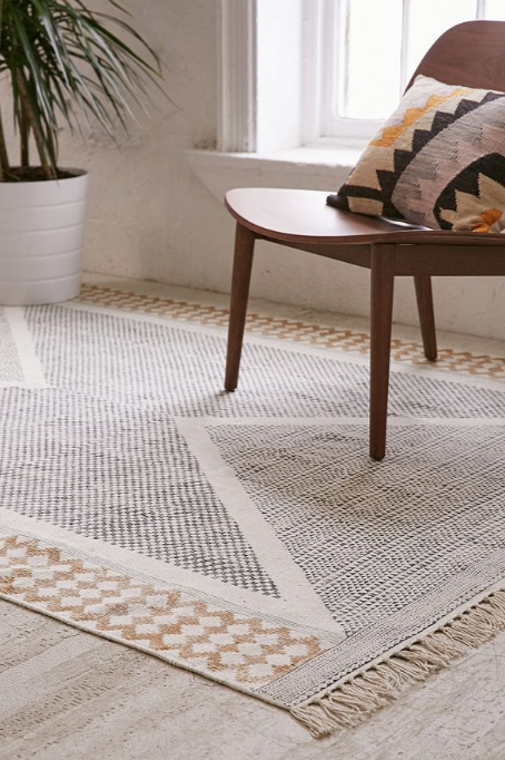 Is It Okay To Put An Area Rug On Carpet