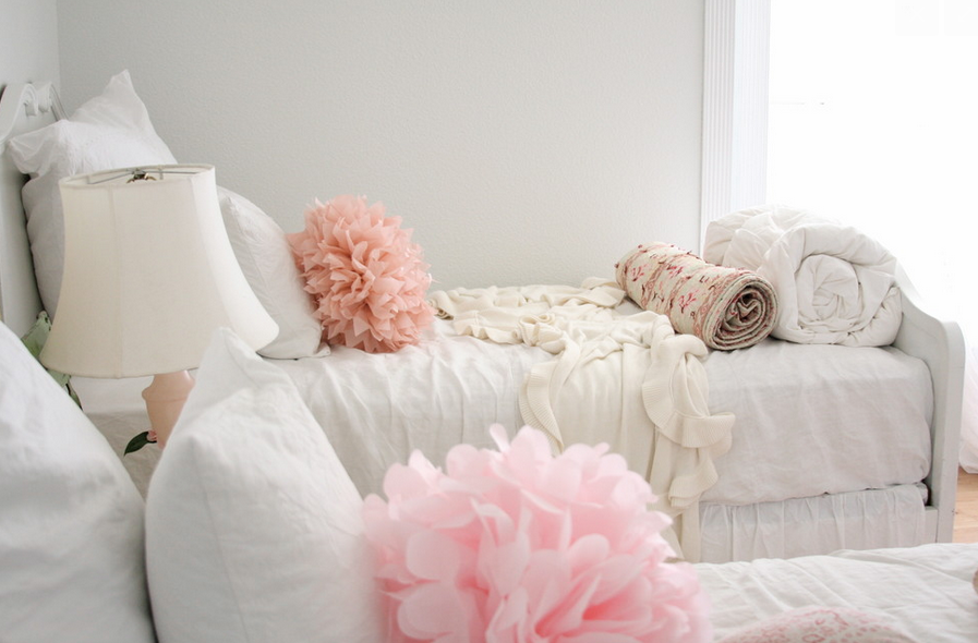 Layers of whites for a dreamy white bedroom   Source