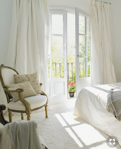Dreamy white bedroom with a classical chair   source