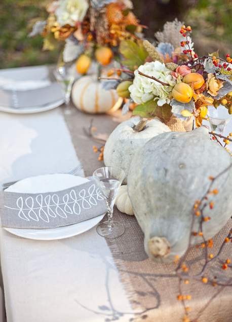 White and neutral color pumpkin fall centerpieces   source