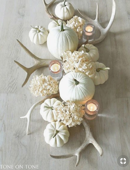 White pumpkin fall centerpiece with candles and flowers   source
