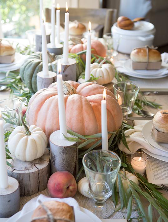 White and pastel orange pumpkins fall centerpiece   source