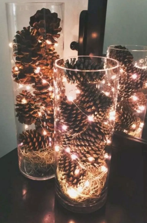 Christmas lights and pine cones IN glass vases   image source