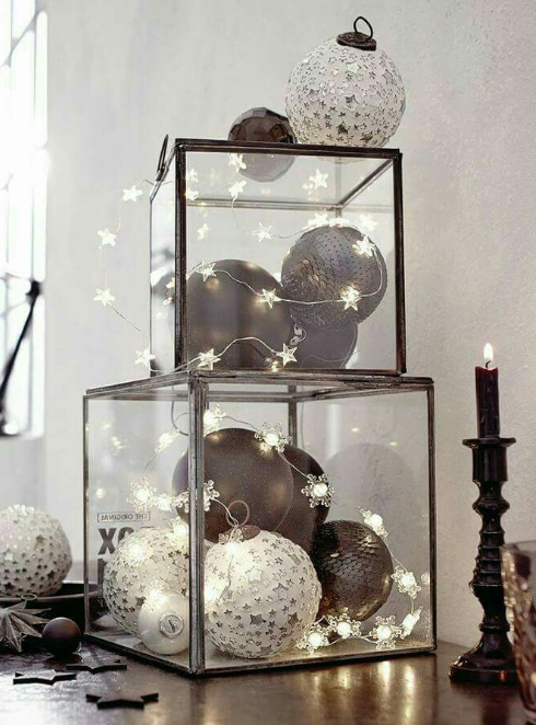 Christmas bulbs and lights in glass boxes   image source