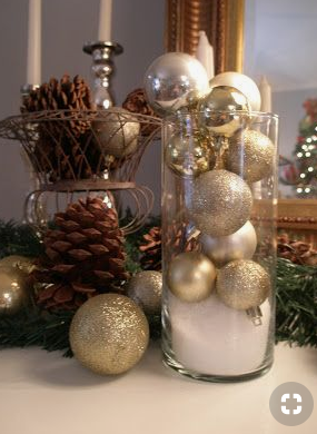 Silver Christmas ornaments in a vase   source