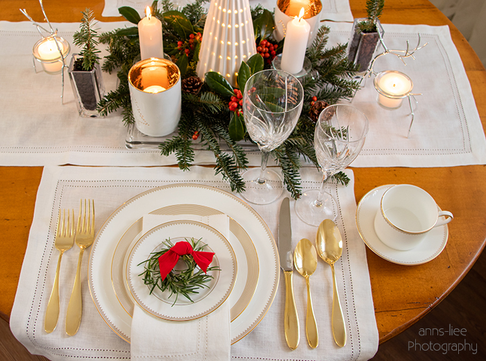 Christmas place setting in gold and white
