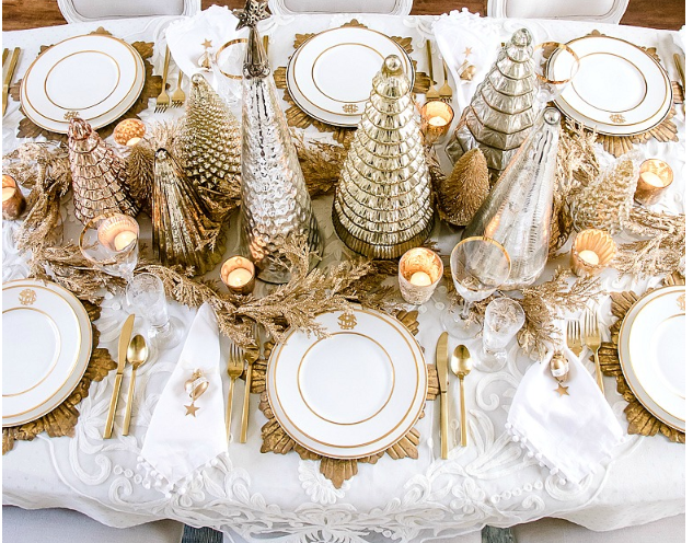 Gold and white tablescape   source