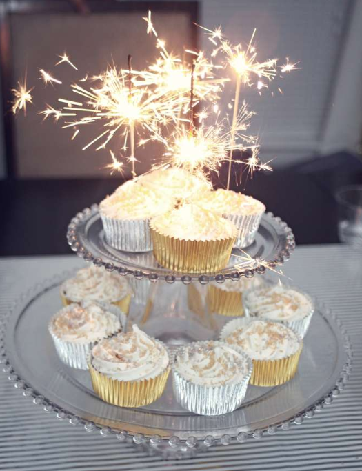 Cupcakes with New Year's sparklers   source