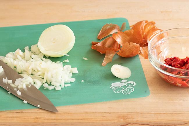 cutting a yellow onion