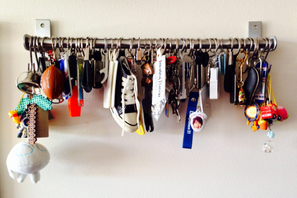 key chain collection hanging on a bar   source