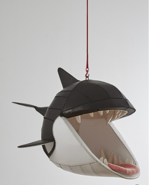 As seed on   Architectural Digest  , swinging leather shark chair by Porky Hefer at the Design Miami booth of  Southern Guild