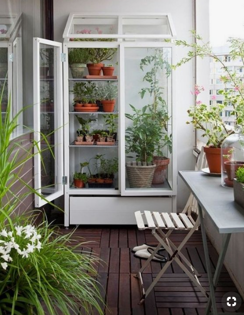 upright free-standing green house on balcony  source