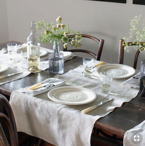 Simple white table place setting   source