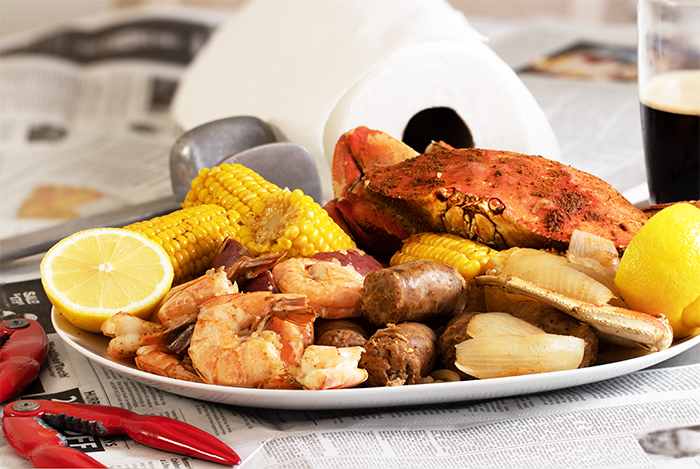 crab boil with shirmps, sausages, corn and potatoes
