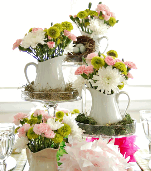 Spring bouquets in four ceramic pitchers raised on varying acrylic stands. From HGTV.com