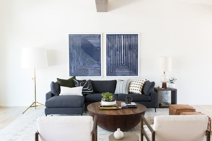 White wall, medium blue sofa and and blue pictures source   Studio McGe  e