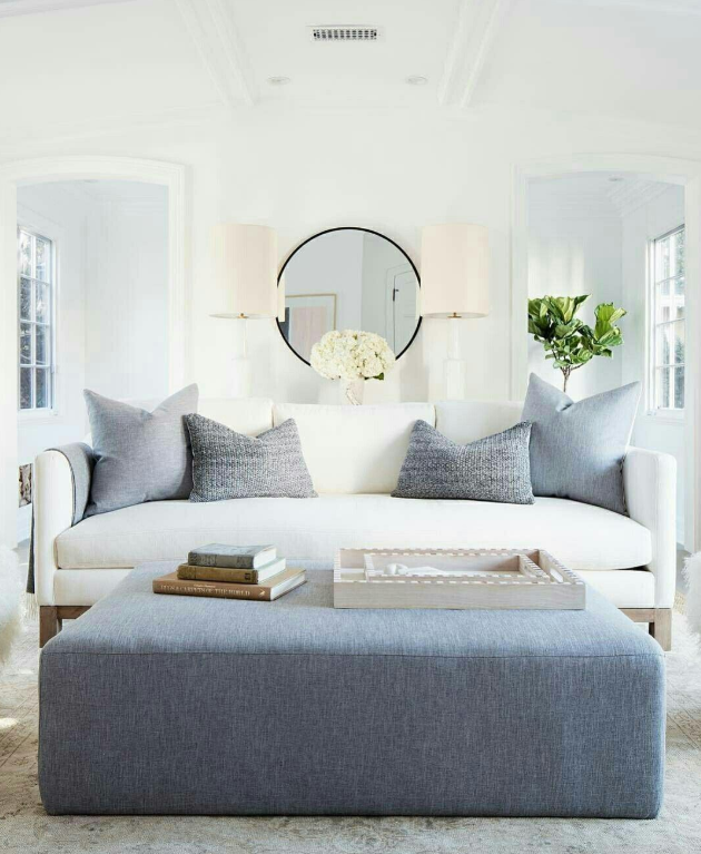 White walls, white sofa, and blue accents   source