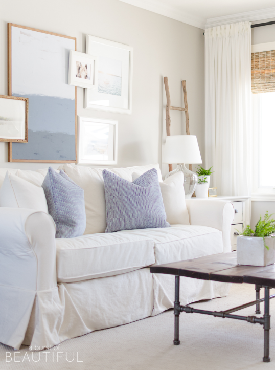 White walls, white sofa and light blue accents source:   A Burst of Beautiful