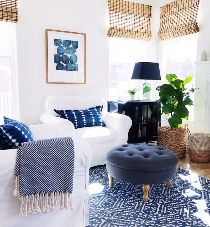 White Walls, white club chairs and blue accents source   Jane atHome