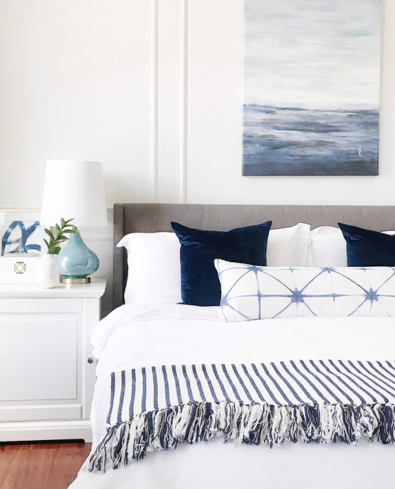 White wall and blue accented bedroom source   Jane at Home