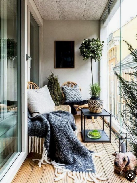 Blue and white decor on porch   source