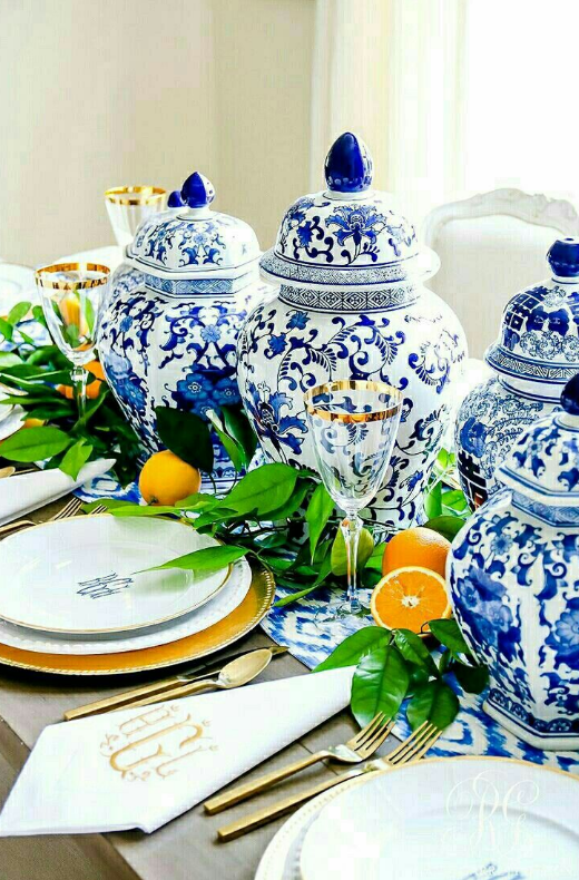 White walls and blue/white table setting in dining area   source