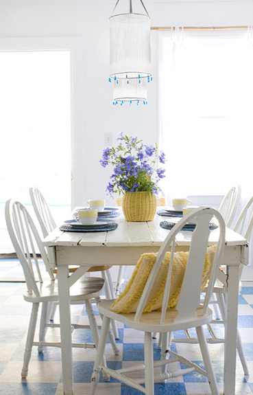 White walls blue accent in dining area source:   The Lettered Cottage