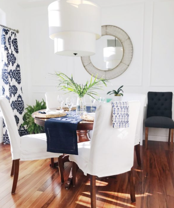 White walls blue accents in dining area   source