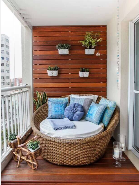 White walls blue accent on balcony   source