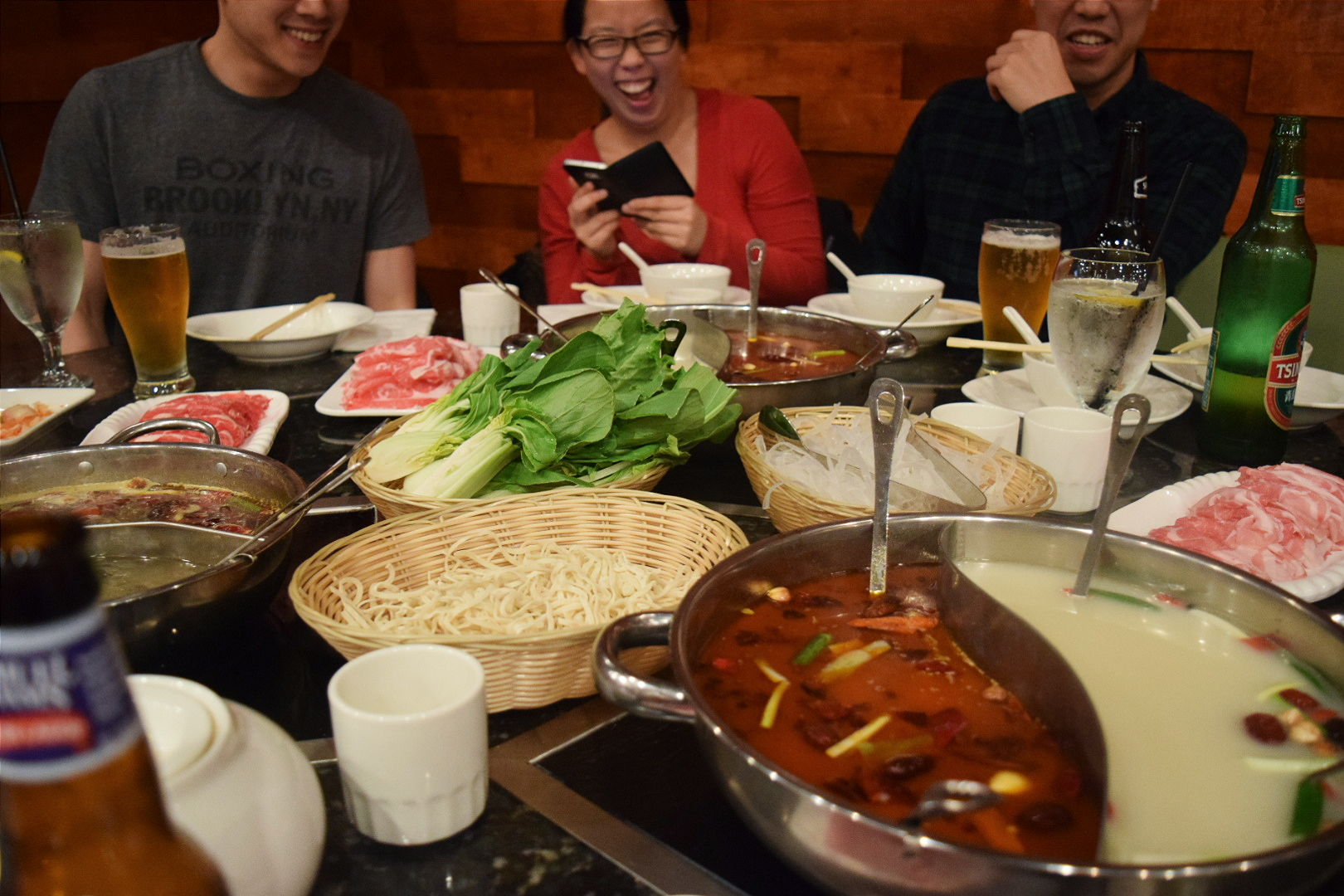 Michael, Maggie, and Danny sharing a laugh (probably at our bumbling chop stick skills)over all the delicious food they ordered. The fish balls and quail eggs were especially trick with sticks, but probably the hardest to scoop out were the noodles.  Photo by Holly T.
