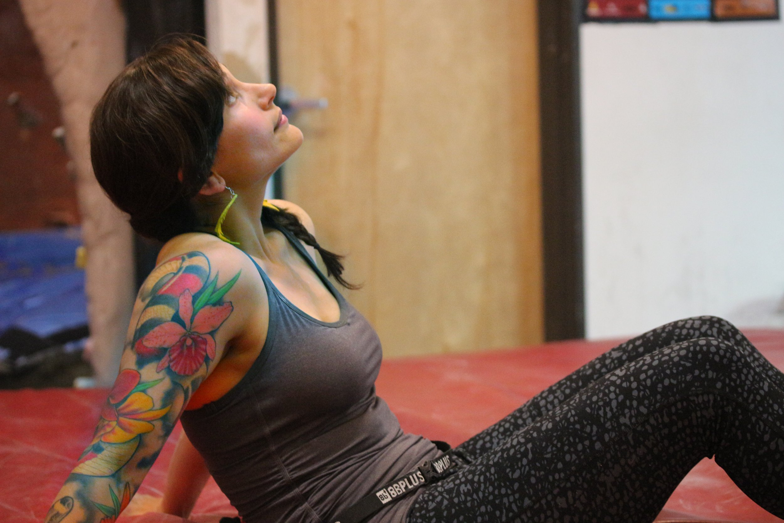 Missy from Team SW/AG, taking a break in the highball bouldering room.