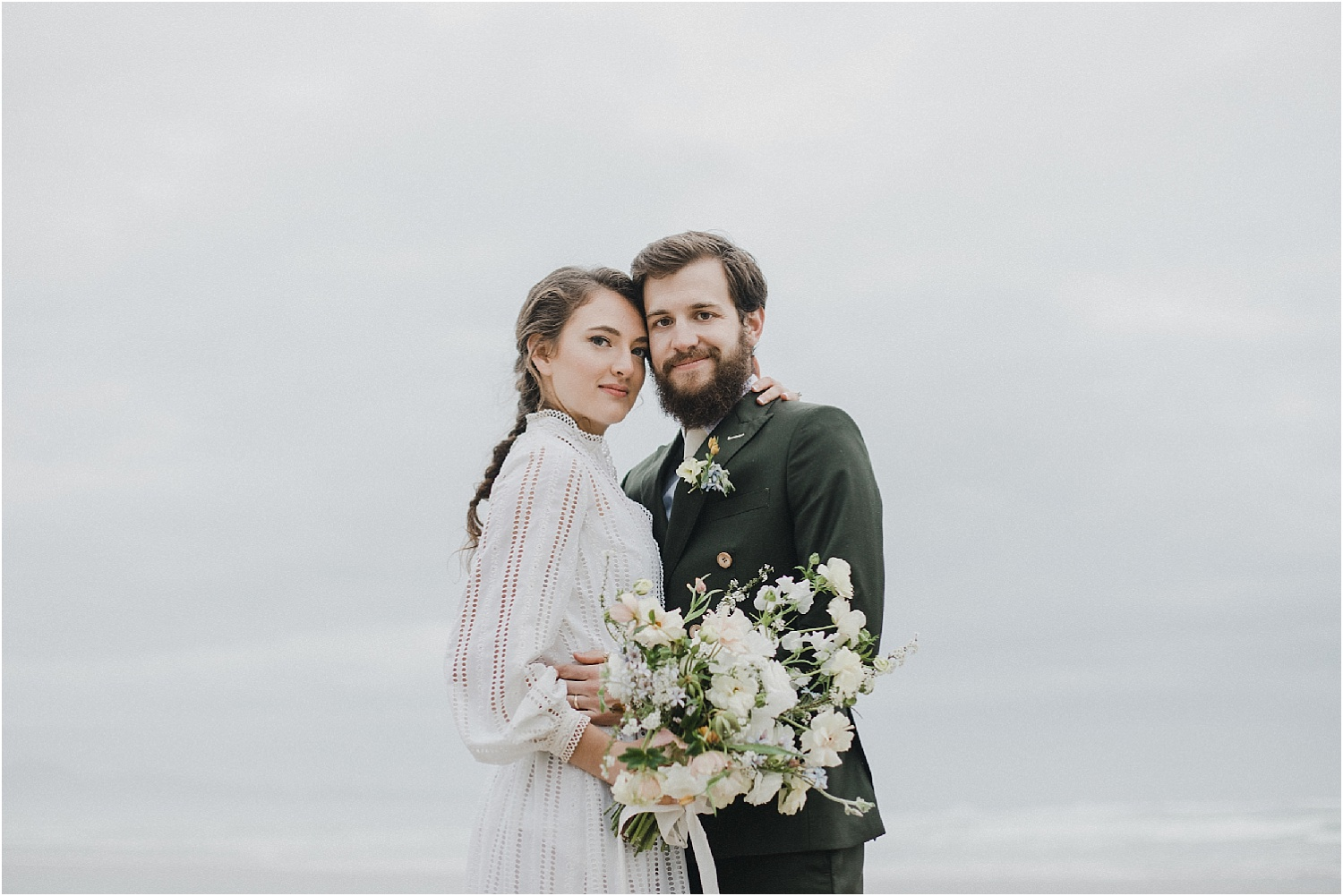 A bride and groom elope at Cannon Beach on the Oregon coast. The Oregon Coast is the perfect place for an intimate elopement or a larger wedding ceremony. Check out this couple's adventurous elopement captured by Alixann Loose Photography.