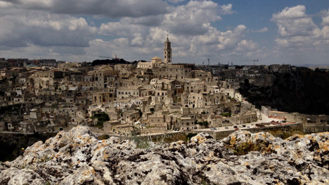 MATERA: CITY OF STONE    An American filmmaker reunites his family in the Stone Age Italian city of caves and extreme poverty that his grandfather fled a century ago.