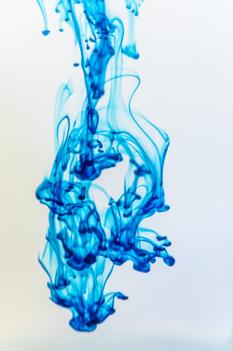 Food coloring flowing through water