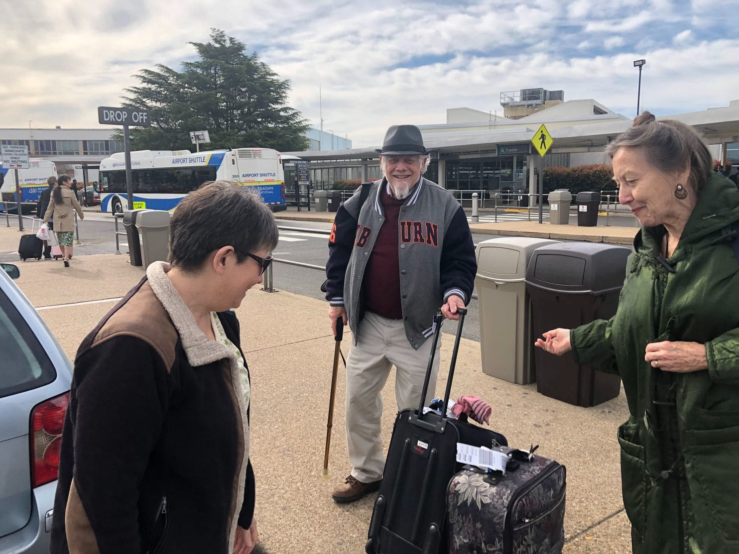 Susan Alexander, left, brings passengers Mary and Al Liepold to Reagan National Airport. All three are members of the Silver Spring Time Bank. (Justin Wm. Moyer/The Washington Post)