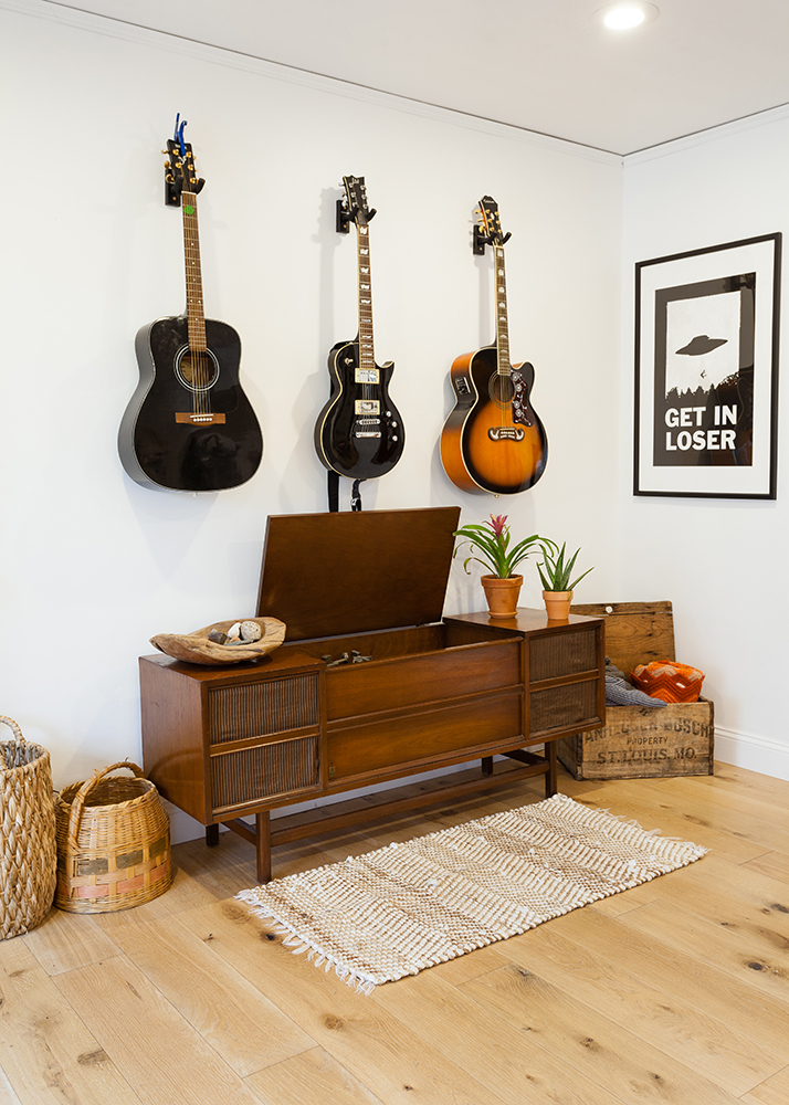 Guitar hangers and midcentury record console