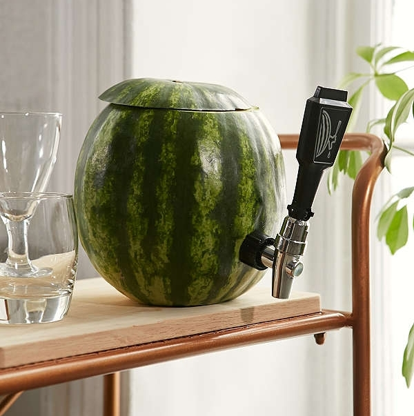 Watermelon Keg Tapping Kit - When you are having an identity crisis about the fact that your keg tapping days are over and you're more excited about Pinterest-worthy party details, this fun little accessory will help bridge the gap. Plus, when you're trying to beat the heat, you may as well have a fruity drink in hand.