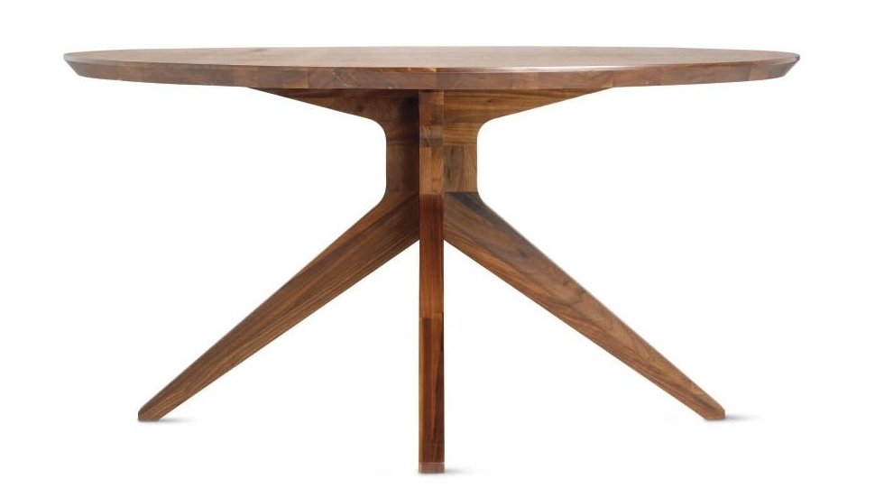 Design Within Reach | Cross Round Table ($4875) - This Mathew Hilton table from Design Within Reach is made of solid walnut, which sounds fancy, but solid wood has a tendency to contract and expand with the weather, making it less stable at times. This piece is 59