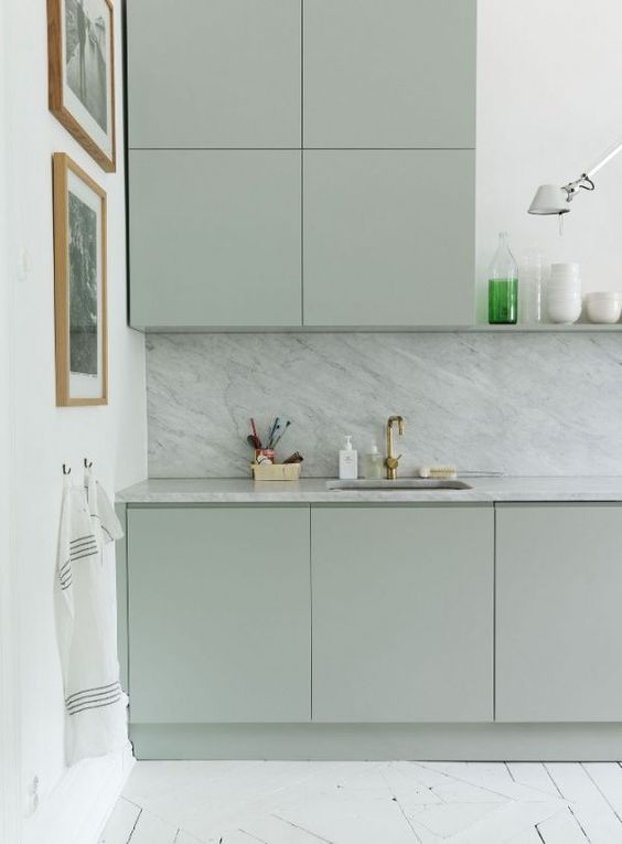 Serene kitchen dreams. - The serene green blue cabinets paired with the marble backsplash creates the ultimate calm and peaceful kitchen. Also love the blank cabinets with no ornaments—super calming.Photo by: My Living