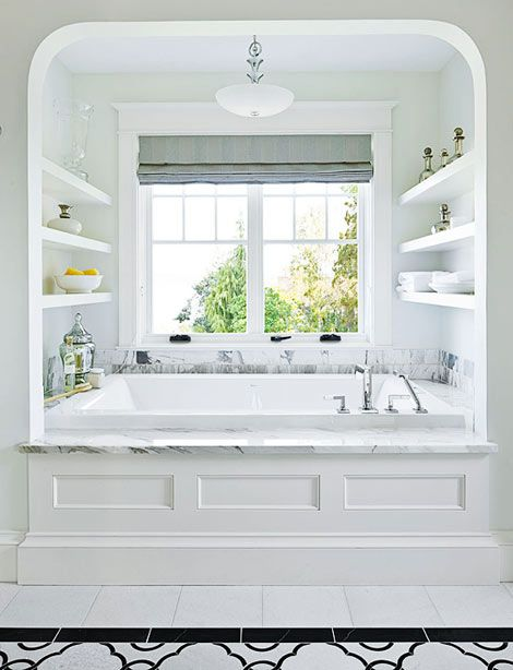 Bath and shelves. - Not only does this seem like the most ideal place to take a bath after a long day, but the added shelves on both sides for storage are simple and genius! Towel, bath bombs and essential oils all in arms reach...ahhhh.Photo by: Home Made in Heaven